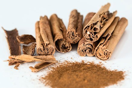 A photo of cinnamin quills and powder.