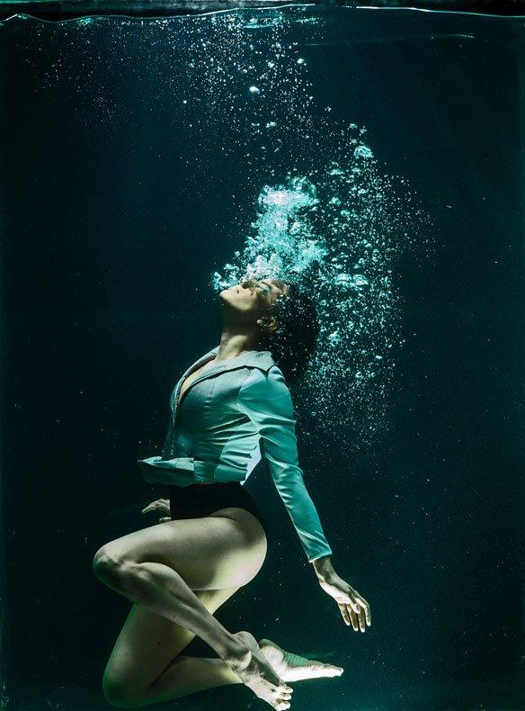 Woman Blowing Bubbles in Water