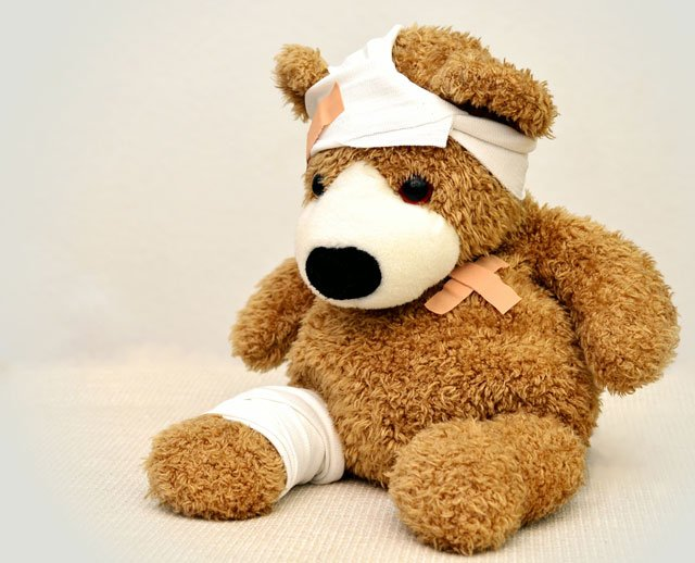 Photo of teddy bear all bandage up from boo boos.