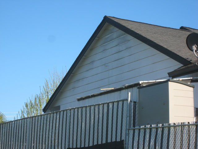 A photo of black mold on house.