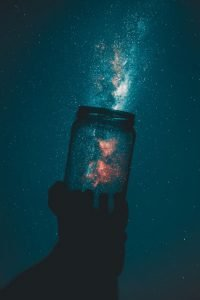 Photo of a cup releasing energy out into the universe.