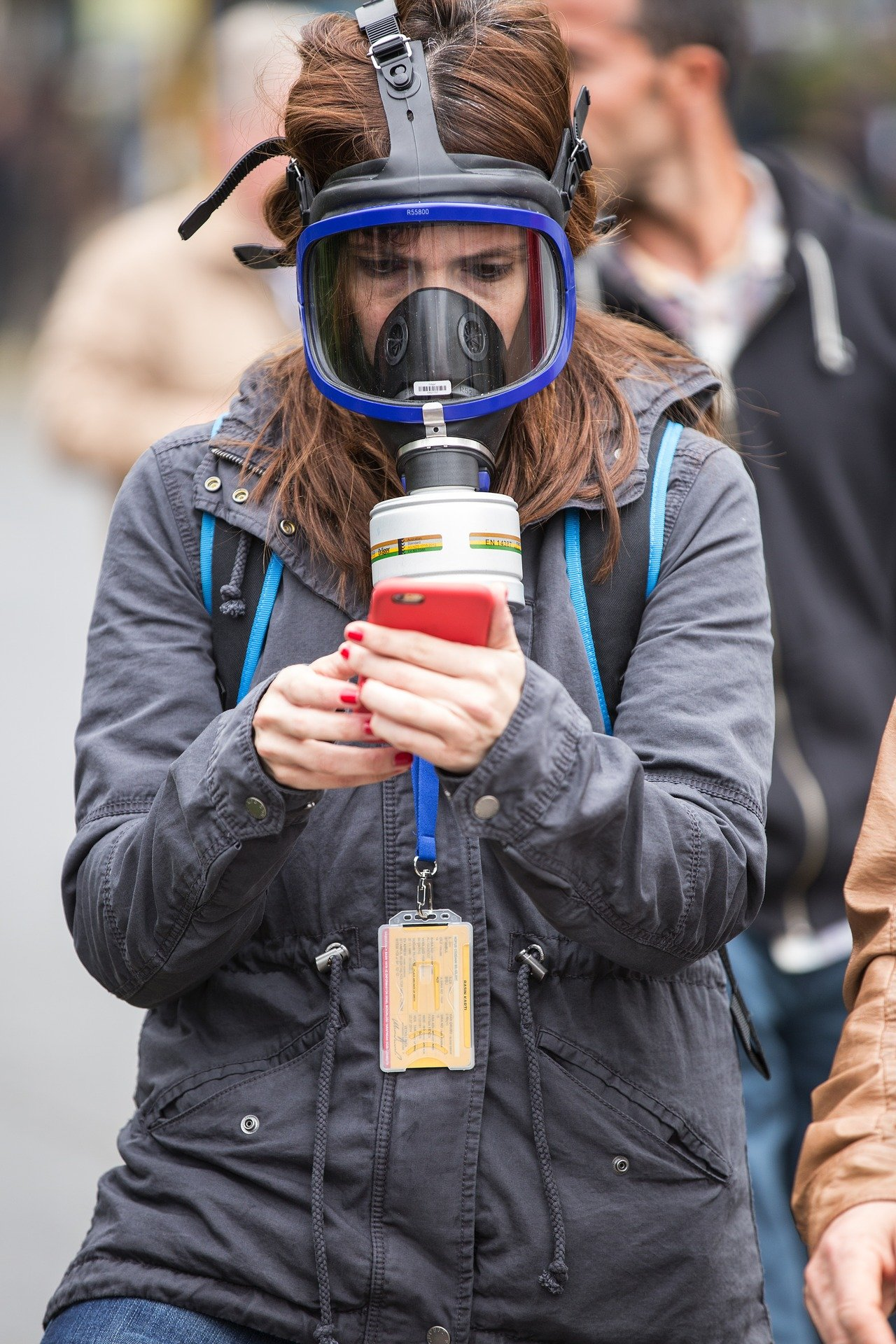 A photo of a woman in a gas mask.