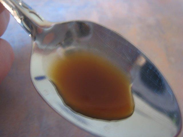 Vanilla tincture on a spoon.
