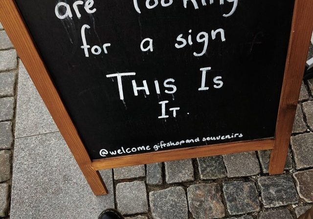 "blackboard sign says ""If you are looking for a sign this is it"""