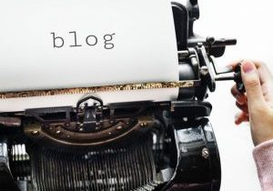 Photo of a typewriter and the word blog on the page.