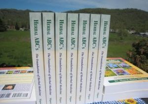 Photo of Herbal ABCs books with mountains in background..