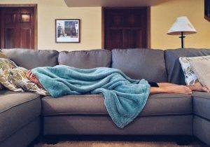 Photo of a sick person on couch.